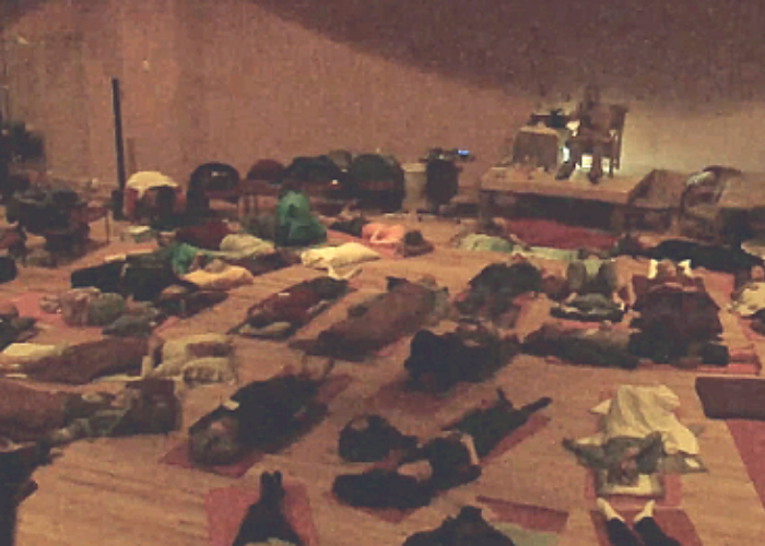 photo of people participating in end of the day group healing sessions